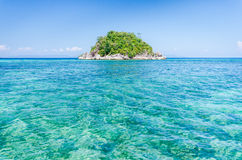 Paradise island. Alone small paradise island in Andaman ocean with clear blue sea and sky Stock Photos
