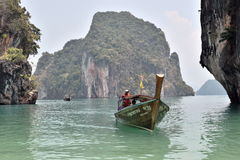 Paradise island boat, Thailand. Photo taken from Paradise Island in Thailand as a longtail boat arrives Stock Image