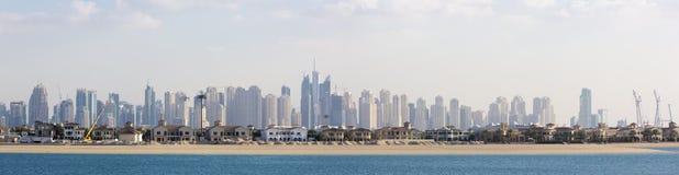Paradise island and high Marina skyscrapers in Dubai Royalty Free Stock Photos