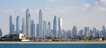 Paradise island and high Marina skyscrapers in Dubai Royalty Free Stock Image
