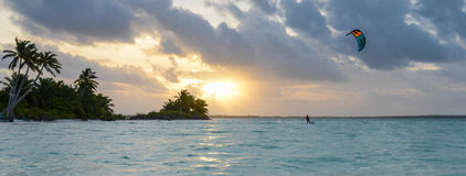 Paradise island. A kite surfer enjoyed a secluded tropical island paradise in the pacific Stock Photography