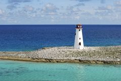 Paradise Island Lighthouse. The view of Bahamian Paradise Island lighthouse in colourful background of Caribbean sea Royalty Free Stock Image
