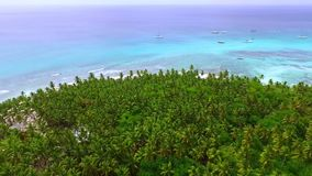Paradise Island in the middle of the open ocean with clear blue water stock video footage