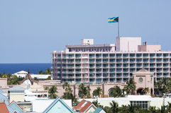Paradise Island Resorts. The view of a resort building with a flag of The Bahamas on Paradise Island stock photo