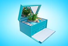 Paradise island in the shape of heart in blue jewelry box, isolated. Paradise island in the shape of heart with palm trees, desk chairs on sand and yacht in open Stock Image
