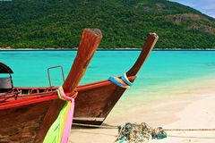 Paradise island and two boats in the green ocean Stock Image
