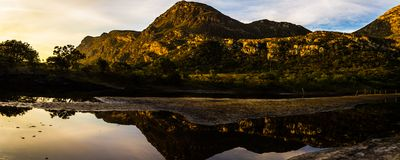 Paradise , Lapinha peak at sunset on a calm and peaceful day royalty free stock photography