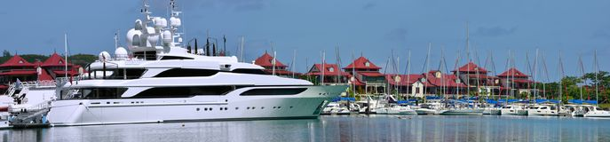 Paradise marine, luxury yachts. Eden island. Panorama. The beautiful luxury yachts are resting in the paradise marina at Eden Island, Seychelles. Panorama. The Royalty Free Stock Photos