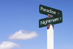 Paradise Nightmare Signs Crossroads Street Avenue Sign Blue Skies. The opposites of Paradise and Nightmares depicted as streets against blue sky ready for your Royalty Free Stock Image