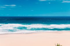 Paradise ocean beach in Margate, South Africa, blue sky, white c. Paradise ocean beach in Margate, South Africa,, blue sky, a few white clouds, yellow sand Royalty Free Stock Photos