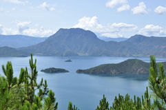 Paradise on plateau. The Lugu lake in the Yunnan-Guizhou Plateau of China Royalty Free Stock Image