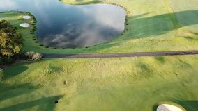 Paradise Point Gold Coast Hope Island Golf Course water trap with jumping fish stock video