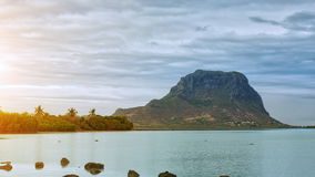 Paradise rocky tropical island at sunset time lapse. Clouds over the Le Morne Brabant UNESCO World Heritage Site at sunset time. Mauritius stock video