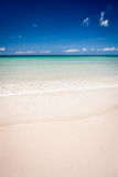 Paradise sand beach on sunny day Royalty Free Stock Photo