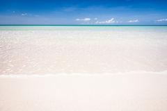 Paradise sand beach on sunny day Stock Images