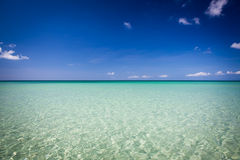 Paradise sand beach on sunny day Stock Photos