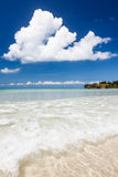 Paradise sand beach on sunny day Royalty Free Stock Image