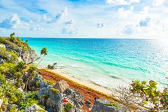 Paradise Scenery of Tulum at tropical coast and beach. Mayan ruins of Tulum, Quintana Roo, Mexico royalty free stock photos