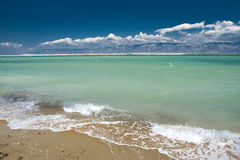 Paradise sea. Beautiful sea with mountains and clouds in the back royalty free stock images