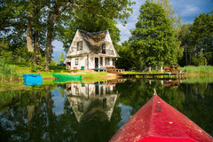 Paradise - small wooden house on the lake Stock Photography