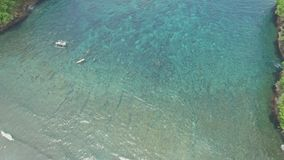 Paradise Snorkeling Shallow Water Reef Aerial 4k. Aerial footage of a beautiful snorkeling bay with shallow water in Nusa Penida, Indonesia stock footage