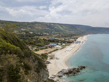 Paradise of the sub, beach with promontory overlooking the sea. Zambrone, Calabria, Italy. Aerial view. Paradise of the sub, beach with promontory overlooking royalty free stock images