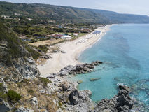 Paradise of the sub, beach with promontory overlooking the sea. Zambrone, Calabria, Italy. Aerial view Stock Photos