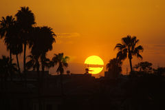 Paradise sunset. Sunset behind a tropical silhouette in Turkey stock photography