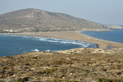 Paradise for surfers. Sea landscape with land neck and surfers. Western coast of Rhodes island, Greece. Prassonissi cape is a favourite place for windsurfers Stock Images