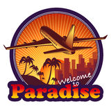 Paradise travel label. With airplane on sunset background Stock Photos