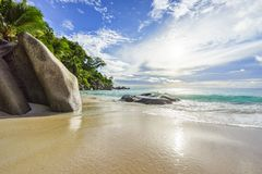 Paradise tropical beach with rocks,palm trees and turquoise wate. Amazing beautiful paradise tropical beach with granite rocks,palm trees and turquoise water in Stock Photography