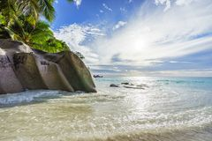 Paradise tropical beach with rocks,palm trees and turquoise wate. Amazing beautiful paradise tropical beach with granite rocks,palm trees and turquoise water in Stock Image