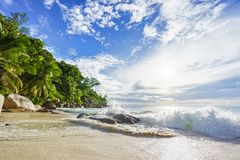 Paradise tropical beach with rocks,palm trees and turquoise water in sunshine, seychelles 23. Amazing beautiful paradise tropical beach with granite rocks,palm stock image