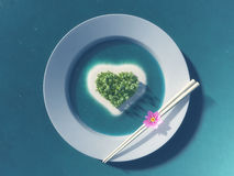 Paradise tropical island in the form of heart. In white plate with chopsticks Stock Image