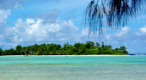 Paradise tropical island, a motu in a lagoon Royalty Free Stock Photography