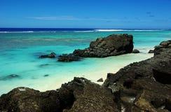 Paradise tropical island, a motu in a lagoon Royalty Free Stock Image