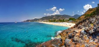 Paradise tropical lagoon with rocky beach in Alanya, Turkey. Sea and mountains landscape in sunny summer day. Alanya beach panoramic view. Tropic bay with stock photography