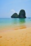 Paradise tropical sand sea beach with rock Stock Photos