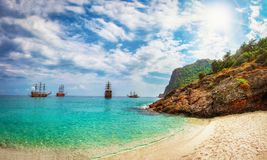 Paradise tropical sea bay with ships. Landscape of sea, rocks on beach with white sand. Lagoon in summer sunny day. Turkey. Royalty Free Stock Photography