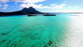 Paradise turquoise clear Pacific ocean water beautiful Tahiti island French Polynesia 4k aerial drone panorama seascape stock video