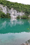 Turquoise Lake with Rocky Background Stock Images