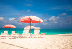 Paradise view of tropical empty sandy plage with umbrella and beach chair Royalty Free Stock Photography
