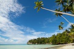 Paradise white sand tropical island beach Royalty Free Stock Photos