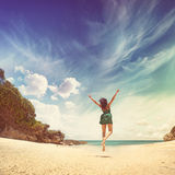 Paradise. Woman jumping on a beach Royalty Free Stock Photos