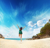 Paradise. Woman jumping on a beach Stock Images