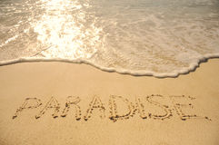 Paradise Written in Sand on Beach Royalty Free Stock Photo