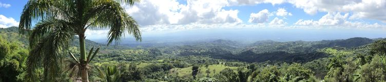 Paradiset i - mellan berg arkivfoto