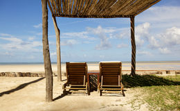 Paradisiac scene of two beach chairs Royalty Free Stock Photos