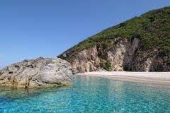 Paradisstrand av Liapades på den Korfu ön Grekland sedimentary royaltyfri fotografi