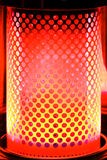 Paraffin Heater with Red Orange Glow. Glowing Element of a paraffin heater. Fading from Dark Red to yellowy orange with wholes punched in sheet metal element Royalty Free Stock Image